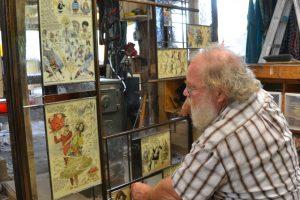 Cain Inc. Wayne Cain Billy Ireland Cartoon Library Museum Installing Panels Into Frame