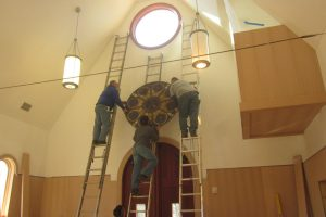 Cain Inc. Wayne Cain Installing Stained Glass Charlottesville VA
